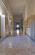 30. Scalone monumentale e corridoio del primo piano in una foto d'epoca e oggi